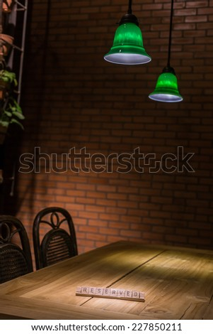 wooden reserved sign in restaurant - stock photo