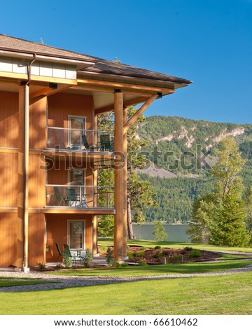 Wooden resort building over beautiful mountain lake. - stock photo