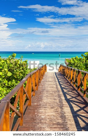 Wooden resort walkway leading to the tropical beach of Varadero in Cuba - stock photo