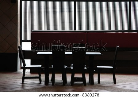 Wooden restaurant table and chairs high contrast