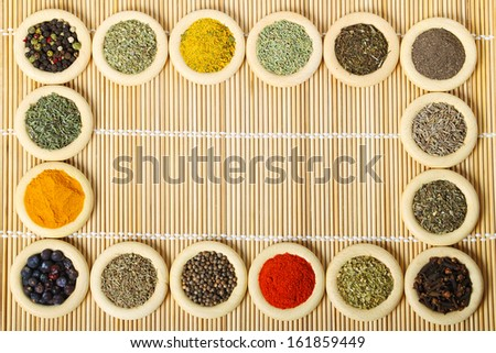 Wooden rings with different spices. Cooking ingredients.