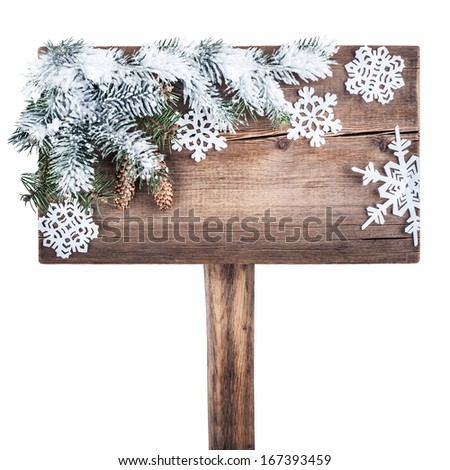 Wooden road sign with Christmas tree in the snow. New Year background - stock photo