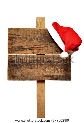 wooden road sign with Santa's hat  isolated on a white background - stock photo
