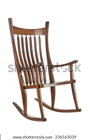 Wooden rocking chair on white background - stock photo