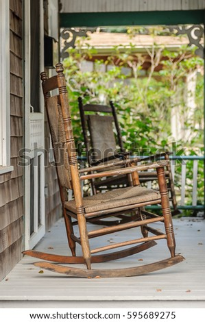 Wooden Rocking Chairs On A Porch Deck