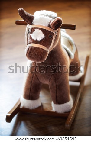 Wooden rocking horse in a childs nursery - stock photo