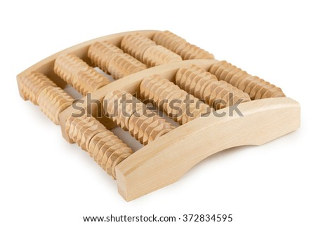 Wooden roller massage tool  for feet Isolated on white - stock photo
