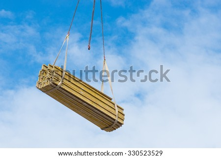 wooden roof beams during construction a new apartments in Poland- Poznan - stock photo