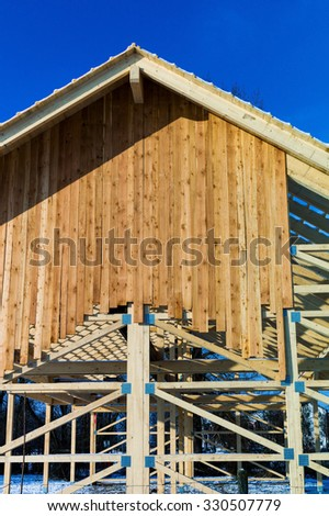wooden roof construction, symbol photo for home, house building, and house financing - stock photo