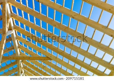 wooden roof construction, symbolic photo for home, home construction, and home financing - stock photo