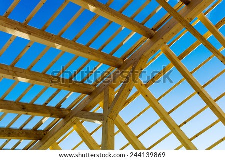 wooden roof construction, symbolic photo for home, house building, and house financing - stock photo
