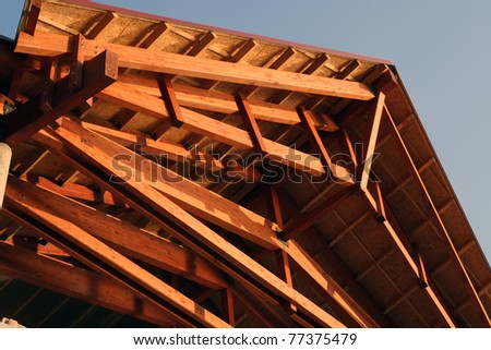 Wooden roof construction. Wooden construction. - stock photo