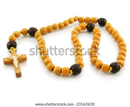 Wooden rosary and cross isolated on a white background