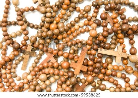 Wooden rosary beads, Useful as texture or background over white - stock photo