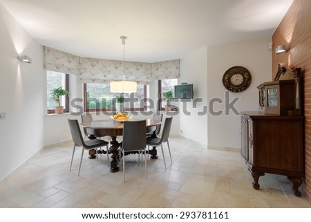 Wooden round table in cozy dining room