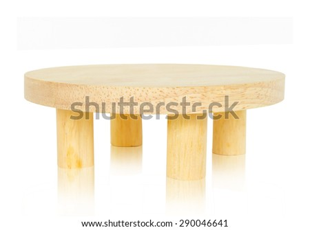Wooden round table isolated on white - stock photo