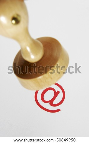 Wooden rubber stamp - internet law - stock photo