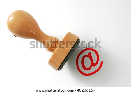 "Wooden rubber stamp - internet law. ""@"" is in focus, stamper is not - stock photo"