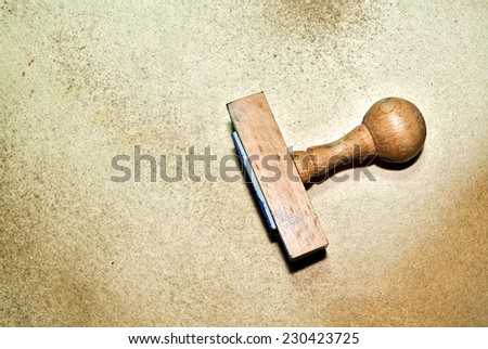 Wooden rubber stamp on grungy paper background - stock photo