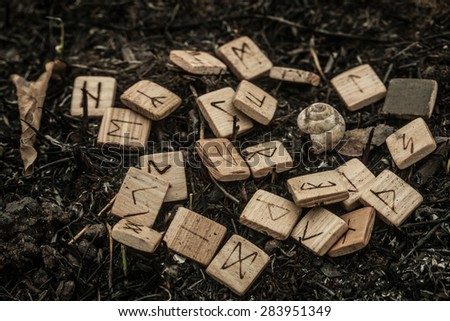 wooden runes on the ground - stock photo