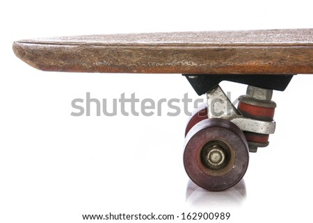 Wooden 70's skate board wheels close up on a white background - stock photo
