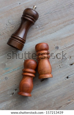 Wooden salt and pepper shakers  - stock photo
