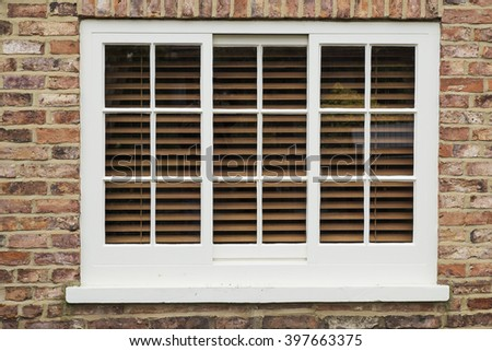 wooden sash window in a brick wall