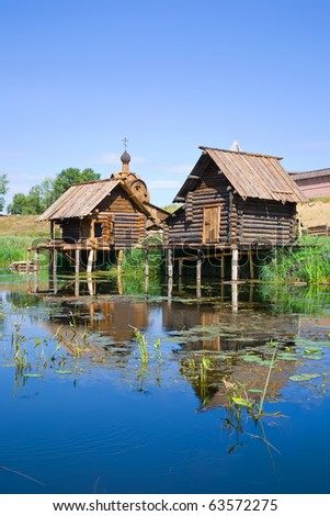 wooden sauna near the lake in summer