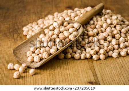 Wooden scoop with chickpeas