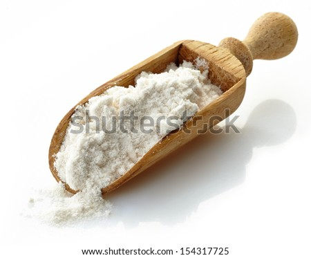 wooden scoop with flour on a white background - stock photo