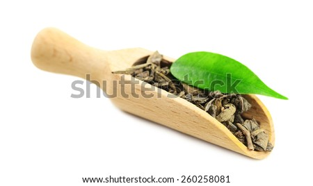 Wooden scoop with green tea with leaf isolated on white  - stock photo