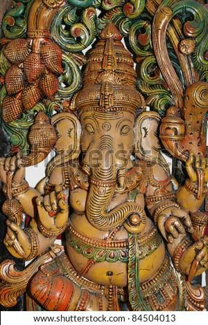 Wooden sculpture of Ganesha, Hindu God of Success - stock photo
