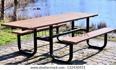 Wooden seat and table in the park portrait - stock photo