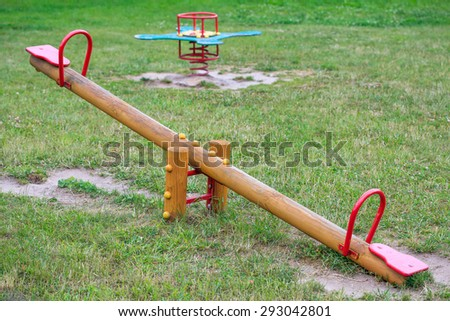 Wooden seesaw on playground - stock photo