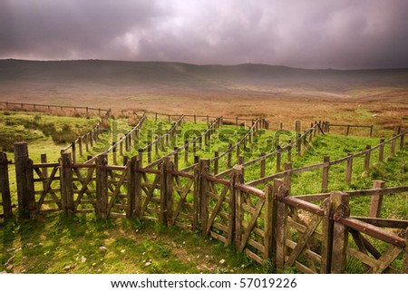Wooden sheepfold complex and Cracoe war memorial on barden moor above Cracoe village - stock photo