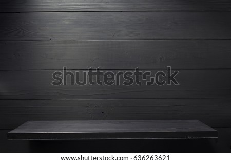 wooden shelf at black background
