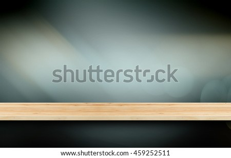 Wooden shelf for present product with Grey gradient blurred abstract background.
