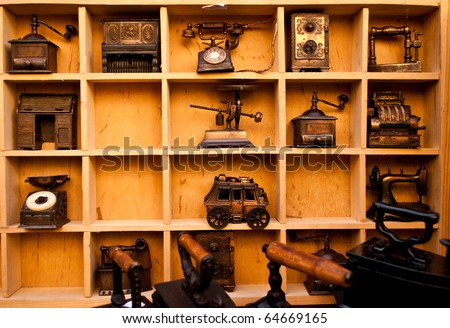 Wooden shelf full of antiques and vintage objects - stock photo