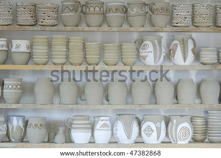 wooden shelf used for drying half processed pottery - stock photo