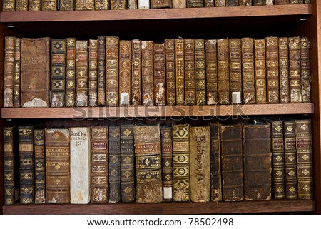 wooden shelf with historic,decorated, vintage books in Biblioteca Joanina part of university Coimbra, Portugal - stock photo