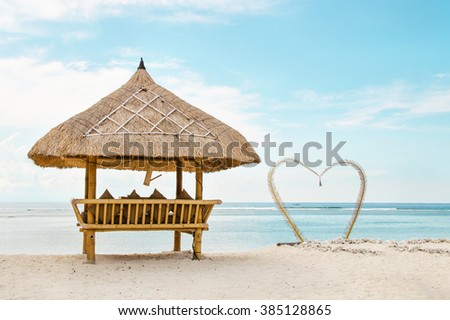 wooden shelter from the sun on the romanti� beach in Bali. Stock image. - stock photo