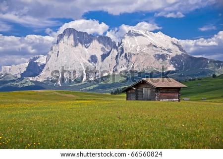 Wooden shelters in Alpe Di Siusi, in the Italian Alps. - stock photo