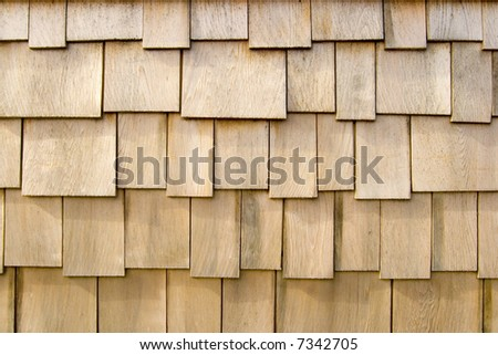 Wooden shingles from the siding of a beach house - stock photo