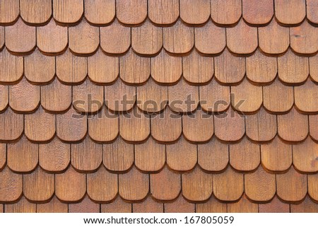 Wooden shingles on house wall - stock photo