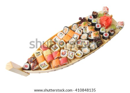 wooden ship with different kind of sushi and  rolls isolated over white background. - stock photo