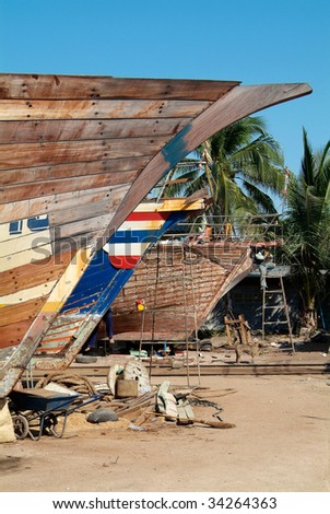 Wooden ships being repaired at a shipyard in Naklua, Chonburi province, Thailand - stock photo