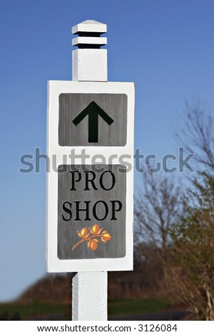 wooden shop sign by golf course - stock photo