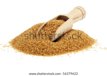 wooden shovel on heap of brown sugar isolated on white - stock photo