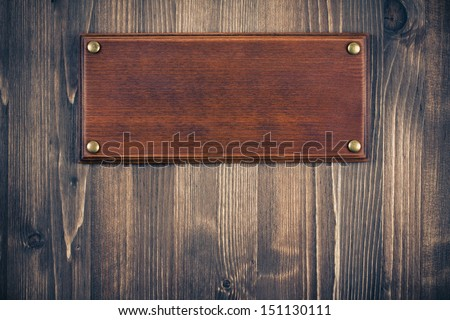 Wooden sign board blank frame on old wood background - stock photo