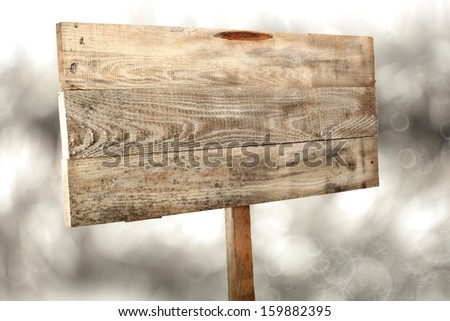 wooden sign in winter time  - stock photo